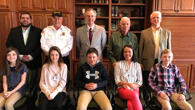 Students serving as City Officials during Mountain Home Kiwanis Student Government Week and their mentors were:(first row, from left)Lana Kawai, Reagan Hawkins, Maddox Carney, Monica Chafin, Brayden Yates, (second row) City Clerk Brian Plumlee, Fire Chief Ken Williams, City Attorney Roger Morgan,Mayor Joe Dillard andPolice Chief Carry Manuel.