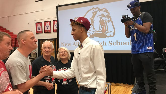 Frank Ward (Right) shoots Romeo Langford as he meets with excited Indiana basketball fans.