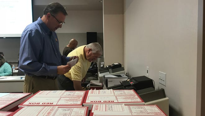 Election workers get ballots for the Oxnard special election ready for the counting machines on May 1.