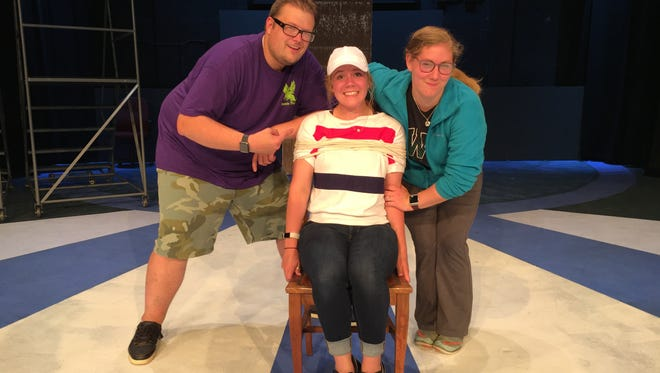 Brandon Byng of Abrams, Michaela Kaiser of Oconto Falls and Samara Kaiser of Oconto Falls rehearse a scene from Urinetown: The Musical being presented at UW-Marinette on July 13-15 and July 20-22. Also in the cast is Katie Schneider of Oconto.