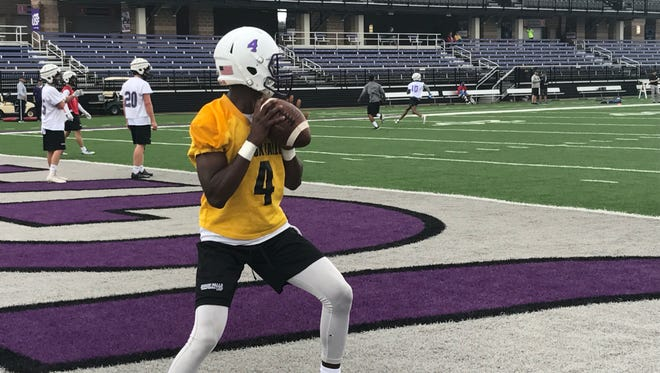 Noah Butler delivers a pass at USF's practice Monday morning at Bob Young Field