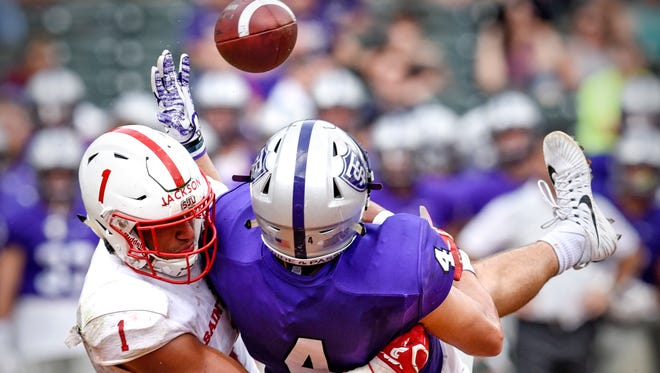 Max Jackson of St. John's breaks up a pass to St. Thomas receiver Vinny Pallini during the Saturday, Sept. 23, game at Target Field in Minneapolis.