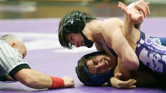 From top, John Jay's (CR) Chris Cook on his way to defeating Suffern's Steven Trombetta in the 120-pound weight class, during a Section 1 dual meet at John Jay High School in Cross River Dec. 6, 2017.