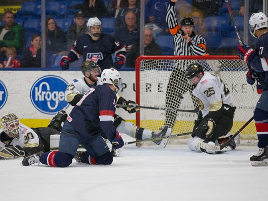 The action gets frantic around the Muskegon goal. The