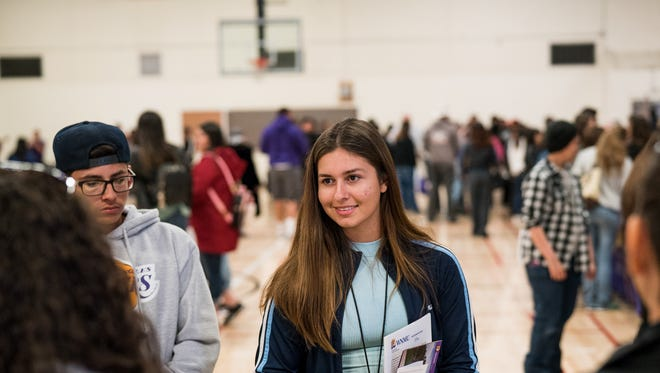 Prospective students gather WNMU literature and meet faculty during an Open House academic showcase.