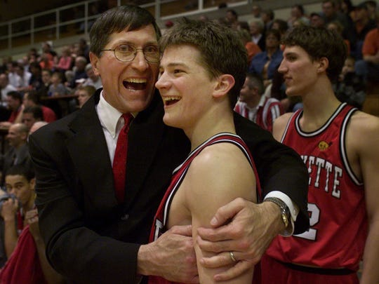 Lafayette Jeff coach Gene Miiller embrace senior Jeff Glinke during the closing seconds of the sectional championship game at Logansport in 2002. The Bronchos defeated Harrison 52-33.