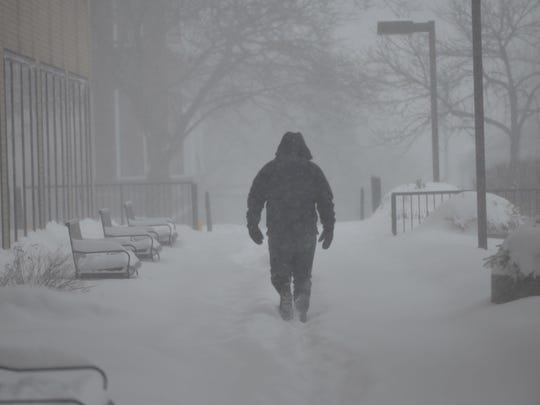A man walks through a blizzard in Burlington on Tuesday, March 14, 2017.