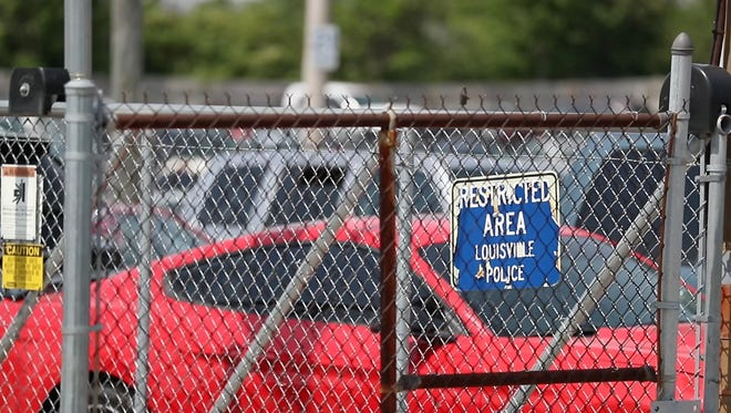 Louisville's 13-acre police impoundment lot is currently above capacity.
