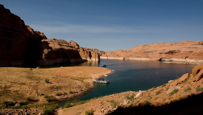 A houseboat pulls onto the beach at the sand dome in Navajo Canyon on Lake Powell. Senate Bill 80 would move a 1/16-cent sales tax currently dedicated to transportation funding and move it into a revolving loan fund set up for water projects - an amount that totaled about $35 million in the last year.
