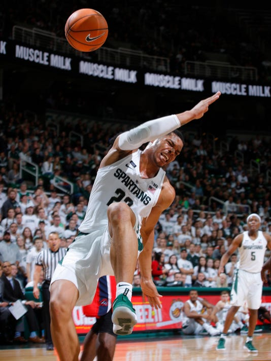 Michigan State's Miles Bridges goes down with an injury as he drives against Stony Brook during the second half of an NCAA college basketball game, Sunday, Nov. 19, 2017, in East Lansing, Mich. (AP Photo/Al Goldis)