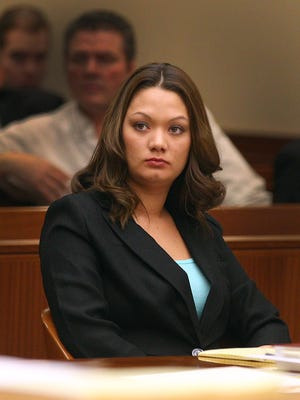 Dawn Nguyen listens as her attorney address the court during her trial.