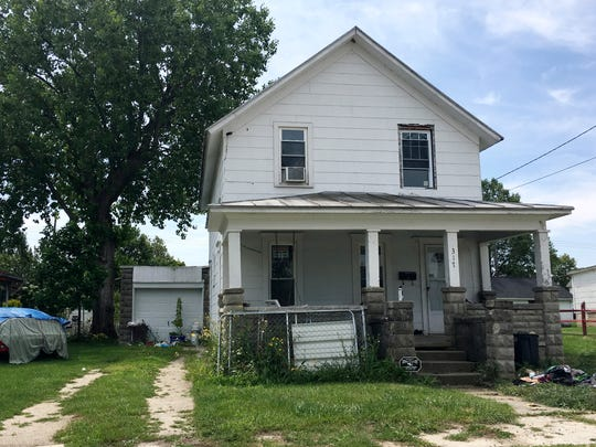 Authorities say a woman was held against her will at this house at 317 E. Stone St. in Gibsonburg, where Chad N. Pickens lived. Pickens has been indicted on felony counts of human trafficking, rape, kidnapping, and felonious assault.