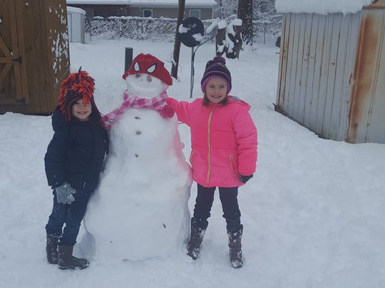 Elah and Asher Massey built their snowman in Swannanoa.