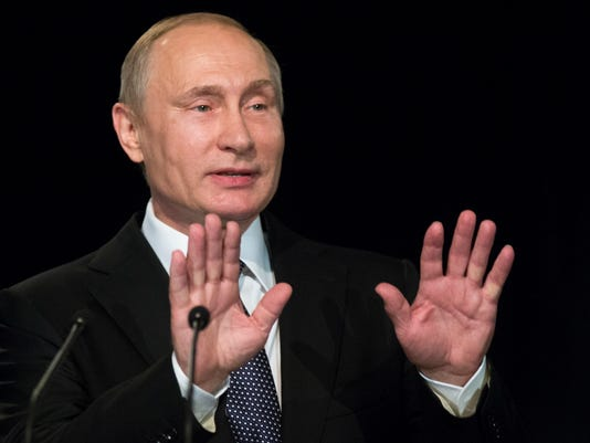 In this photo taken on Wednesday, June 29, 2016, Russian President Vladimir Putin addresses students during his visit to German Embassy school in Moscow, Russia. Putin says in a July 4 message to President Barack Obama that he hopes that the ties between the two countries will get back on track. Relations between Moscow and Washington hit a post-Cold War low in 2014 when Russia annexed Ukraine's Crimean peninsula and threw its weight behind separatists in eastern Ukraine. (AP Photo/Alexander Zemlianichenko)