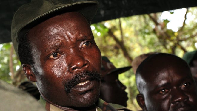 Leader of the Lord's Resistance Army, Joseph Kony answers journalists' questions following a meeting with UN humanitarian chief Jan Egeland at Ri-Kwangba in southern Sudan.