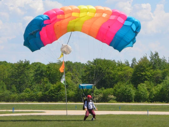 Jake Paquette, a junior at Western Michigan University, lands at the drop zone at Skydive Allegan.
