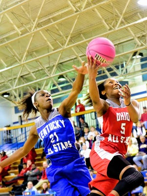 Lakota West's Nia Staples gets into the lane for the Ohio All Stars as Franklin County's Malaka Frank commits the foul.
