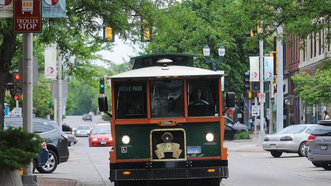 The Sioux Falls Trolley makes its way North on Phillips Avenue through downtown Sioux Falls on May 26, 2015. Downtown Sioux Falls, which has managed the trolley route since 2014, is trying to raise $32,000 by May 27 to help pay for the service.