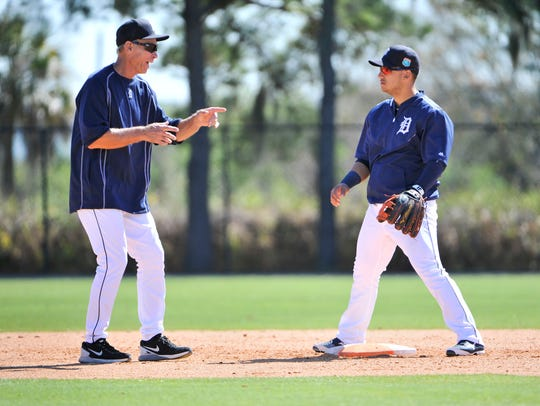 Alan Trammell, left, works with shortstop Jose Iglesias