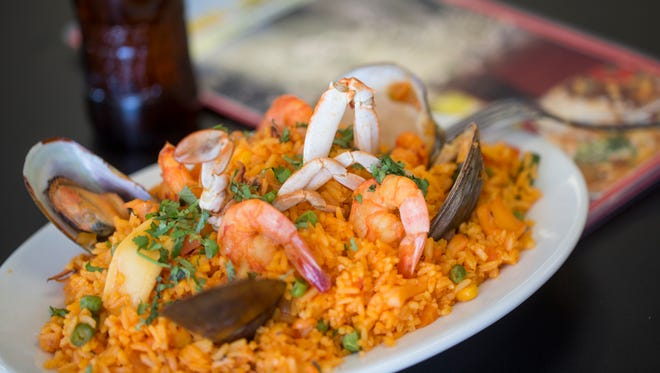 Arroz Con Camarones O Mariscos, shrimp or seafood with rice (Paella style) is on the menu at Lima Limon in Florence.