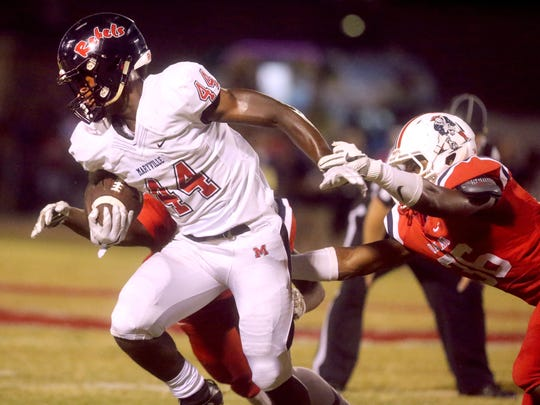 Maryville's Travonis Hodge (44) runs the ball as Oakland's