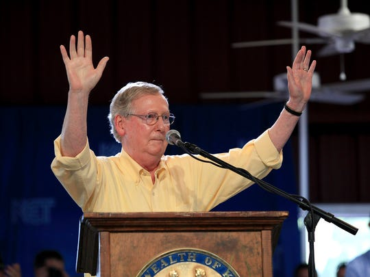 U.S. Sen. Mitch McConnell waved to the crowd following his speech at the Fancy Farm Picnic in 2014.