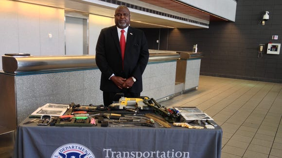 David Wynn, the Federal Security Director for TSA in Mississippi stands by a table of confiscated items.