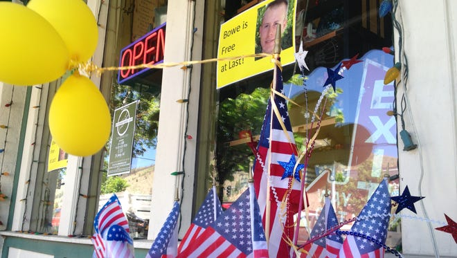 Flags and balloons marking the release from captivity of Sgt. Bowe Bergdahl adorn the sidewalk outside a shop in the soldier's hometown of Hailey, Idaho, on Wednesday. Organizers canceled a planned welcome back celebration, citing concerns crowds could overwhelm the small town.