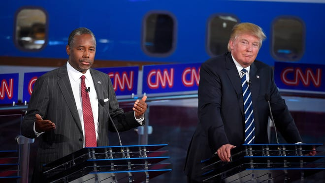 Republican presidential candidates Ben Carson, left, and Donald Trump appear during the CNN Republican presidential debate on Sept. 16.