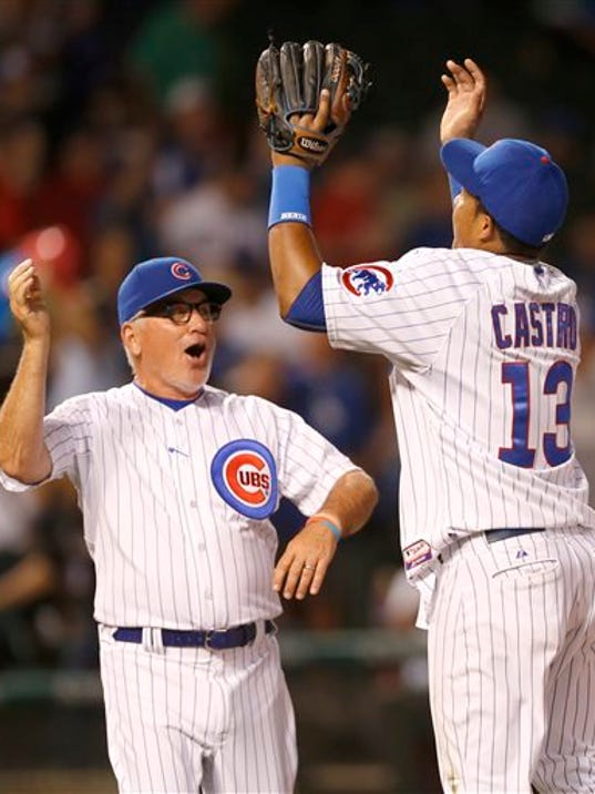Chicago Cubs manager Joe Maddon, left, and shortstop Starlin Castro celebrate the Cubs' 4-2 win over the Los Angeles Dodgers after a baseball game Monday, June 22, 2015, in Chicago.
