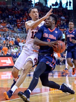 Auburn forward Tyler Harris (12) defends against Mississippi guard Terence Davis (3), Saturday, Feb. 20, 2016, during the first half of an NCAA college basketball game in Auburn, Ala.