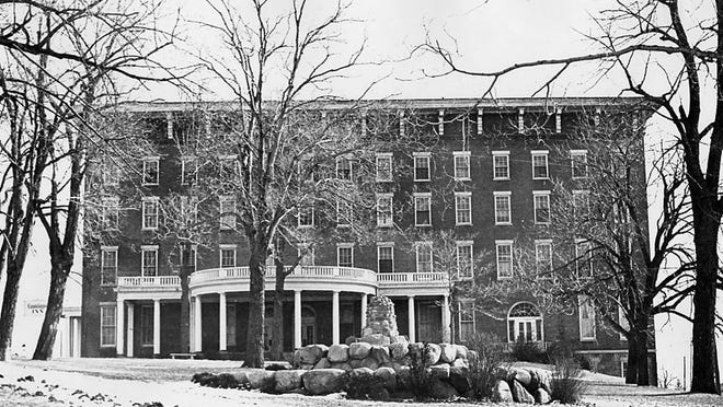 A photograph of the Canandaigua Hotel that Mrs. F.F. Thompson purchased in 1921 for fear that a corset factory was to be built on the site. She modernized it and renamed it the Canandaigua Hotel. Later in 1960 it was renamed the Canandaigua Inn by Marvin M. Rosen.