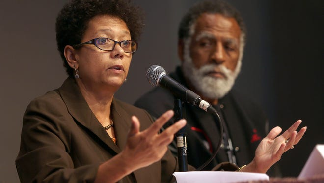 In this July 18, 2013 photo, journalist Dori J. Maynard, left, speaks next to Arnold Perkins of the Alameda County Public Health Department during a forum at Preservation Park's Nile Hall in Oakland, Calif. Maynard, a journalist and champion of diversity in news coverage, died Tuesday, Feb. 24, 2015, at her Oakland home, the Robert C. Maynard Institute for Journalism Education said. She was 56.