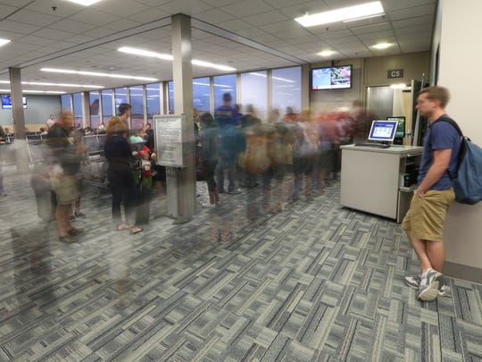 Passengers board a morning flight at the Des Moines International Airport on Tuesday, July 1, 2014, in Des Moines, Iowa.