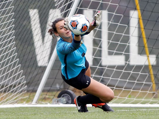 Lansing Christian goalkeeper Lynn Cullens makes a save during the shootout against Kalamazoo Christian, Saturday, June 17, 2017, in Williamston.