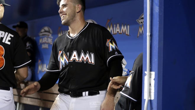 Miami Marlins starting pitcher Jose Fernandez walks in the dugout before a baseball game against the New York Mets, Saturday, July 23, 2016, in Miami. The Marlins defeated the Mets 7-2. (AP Photo/Lynne Sladky)