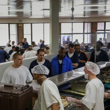 Inmates are served food by other inmates through the Aramark Correctional Services on Tuesday June 24, 2014 at The Charles E. Egeler Reception and Guidance Center in Jackson.
