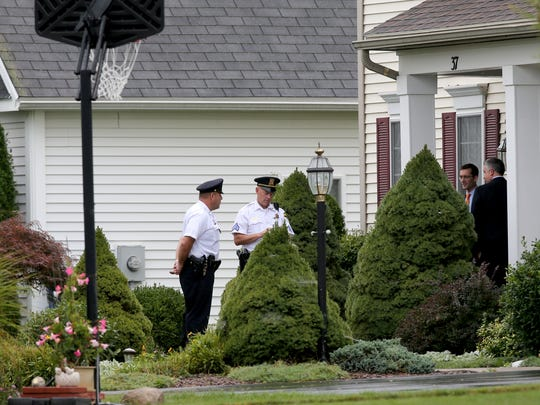 "Charles Tan's defense attorneys open the Tan home in Pittsford to court deputies to conduct a security sweep of the home before jurors were allowed in to view the upstairs office where Liang ""Jim"" Tan, 49, was found dead Feb. 9."