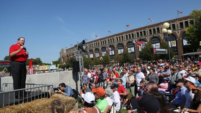 Republican presidential hopeful Mike Huckabee talks to a crowd Thursday at the Des Moines Register's State Fair Soapbox.