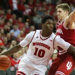 Wisconsin forward Nigel Hayes (10) drives to the basket as Indiana forward Collin Hartman (right) defends  at the Kohl Center. Wisconsin defeated Indiana 82-79 (OT).