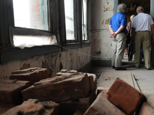 About 40 people toured the Carlisle building Thursday