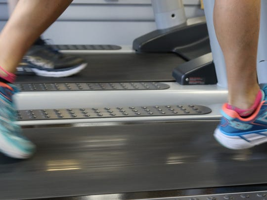 A personal trainer and lacrosse coach in Demarest, N.J., works out on a treadmill.