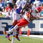 Buffalo's Aaron Williams, knocks a pass away from Kansas City's Dwayne Bowe with a hard hit during a 2012 game. Williams signed a contract extenstion with the Bills on Wednesday.
