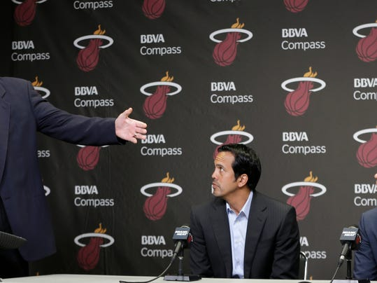 Miami Heat President Pat Riley, left, introduces Shabazz Napier, right, as head coach Erik Spoelstra, center, listens at a news conference in Miami, Monday, June 30, 2014. The Heat acquired the draft rights to Connecticut guard Shabazz Napier in a trade with the Charlotte Hornets on Thursday night, giving up the 26th and 55th picks to make the deal happen, along with a future second-round choice and cash considerations. (AP Photo/Alan Diaz)