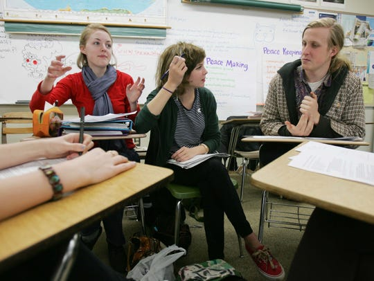 Hannah Plummer (left) Lauren Taylor and Ryan Jenkins meet to discuss their group project on 20th Century wars during IB History of the Americas class at Hillsboro High School in 2010. Hillsboro is one of three public high schools in Nashville to offer IB programs.