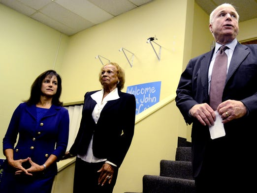 From left, U.S. Senate candidate Monica Wehby, Oregon State Senator Jackie Winters and Sen. John McCain meet with Wehby's supporters at her Salem field office on Thursday, Oct. 2, 2014.
