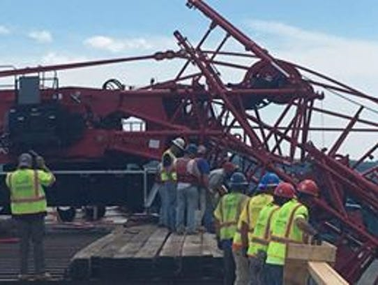 The scene of a crane collapse that has blocked all