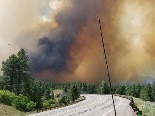 Increased fire activity shut down Highway 550 Friday afternoon. Purgatory Resort Friday also announced it was halting activities until further notice due to the 416 Fire burning 10 miles north of Durango, Colorado.