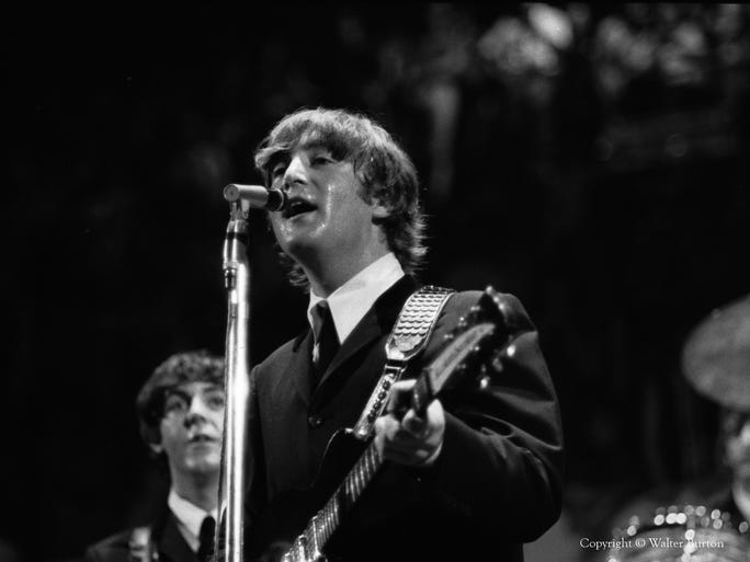 Paul McCartney and John Lennon on stage at Cincinnati Gardens. The Beatles did a dozen songs in about 28 minutes – with the crowd screaming the whole time.