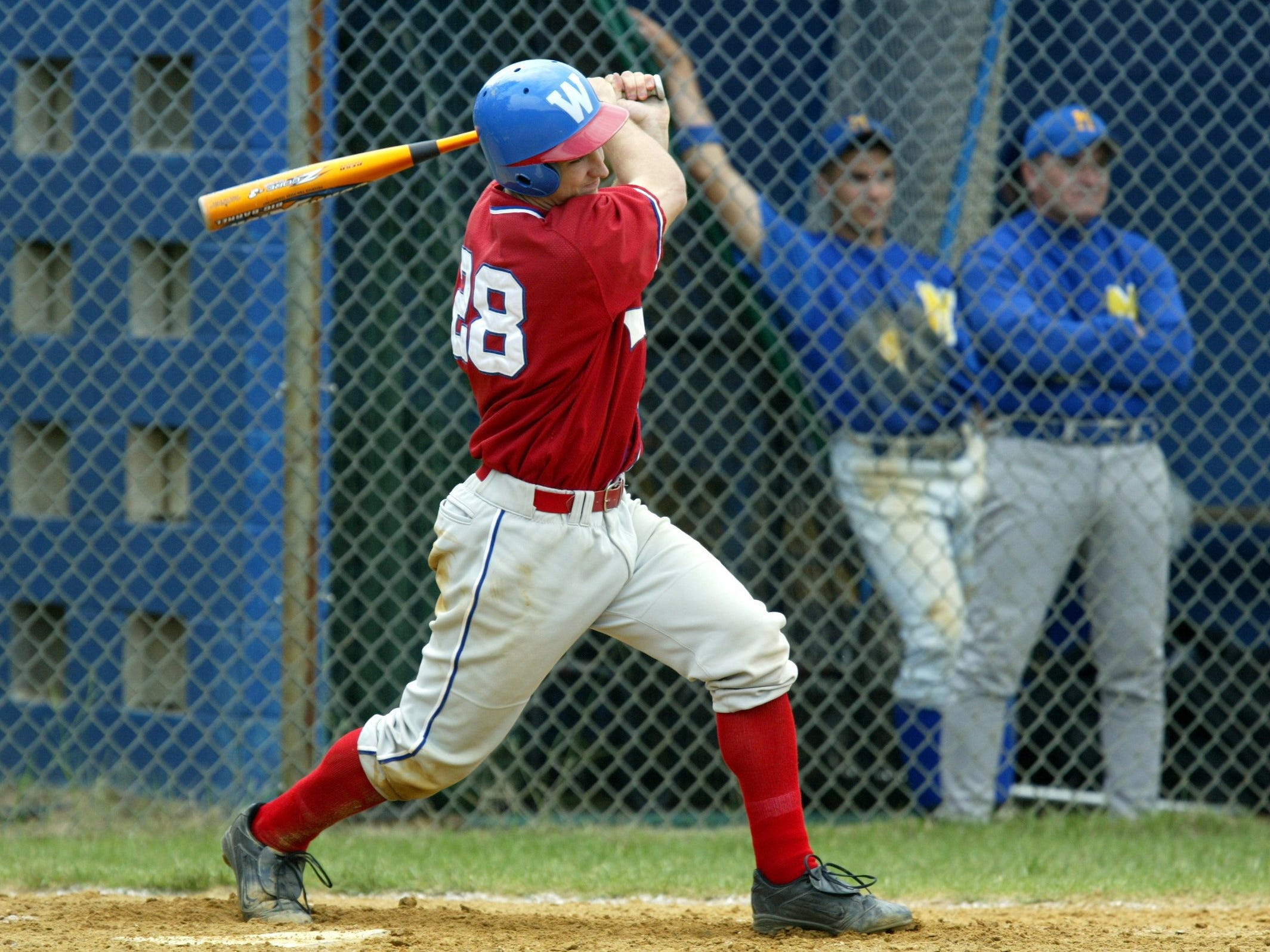 Wall's Evan Baubles rips a ball in a 2003 game. By the end of his career a year later, he was the Crimson Knights' all-time home run leader with 18. .
